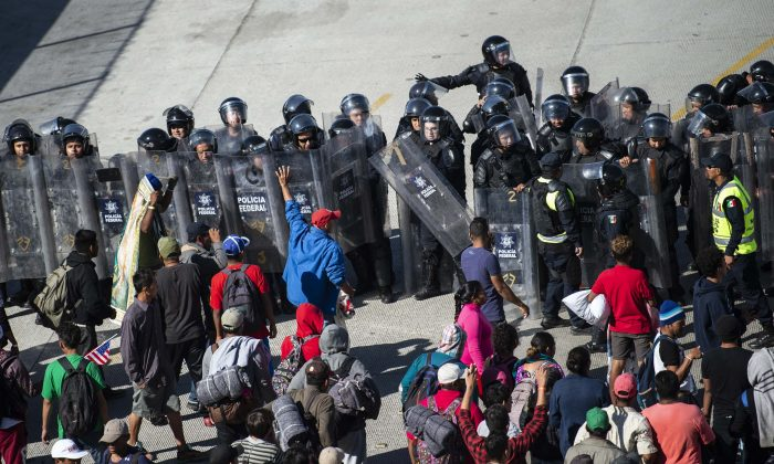 Central American migrants are blocked by Mexican police forces as they reach the El Chaparral border crossing, in Tijuana, Baja California State, Mexico, on Nov. 25, 2018. (Pedro Pardo/AFP/Getty Images)