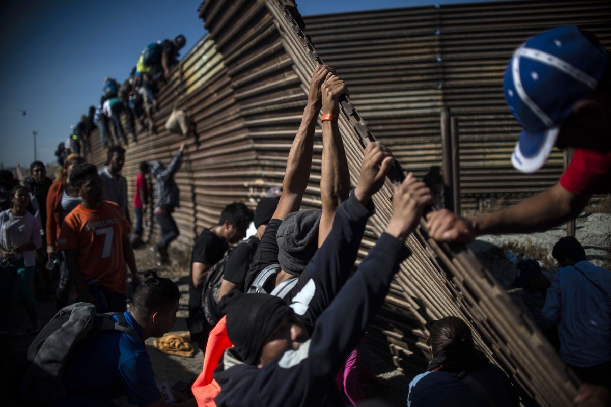 Videos Of The Day Migrants Breach Border Fence Throw Rocks