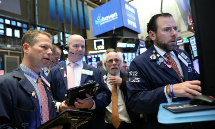 Traders work on the floor at the New York Stock Exchange (NYSE) in New York City, on Nov. 26, 2018. (Brendan McDermid/Reuters)