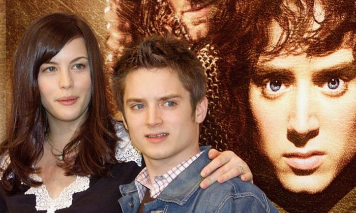 'Lord of the Rings' actors Liv Tyler and Elijah Wood pose for photographers during a press conference in Tokyo, Feb. 20, 2002. (Toru Yamanaka/AFP/Getty Images)