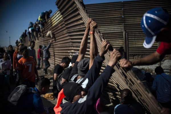 US closes Mexican border crossing, repels some migrants with tear gas