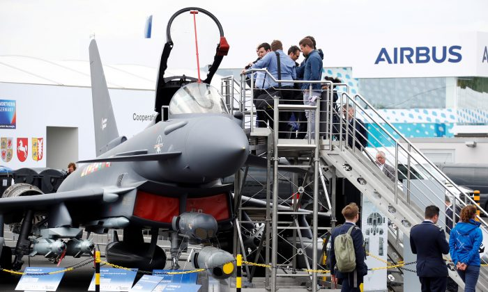 Visitors look at the Eurofighter Typhoon jet during the ILA Air Show in Berlin, Germany, on April 25, 2018. (Reuters/Fabrizio Bensch/File Photo)