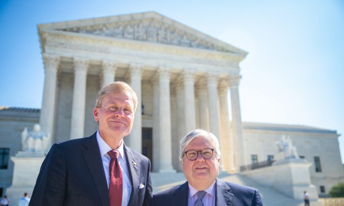 Attorney Mark Miller of the Pacific Legal Foundation and Edward Poitevent, plaintiff in Weyerhaeuser Co. v. U.S. Fish and Wildlife Service, stand outside the Supreme Court in Washington on Nov. 27, 2018. (Pacific Legal Foundation)