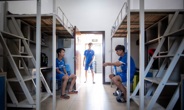 This picture taken on September 21, 2018 shows students in their dormitory after a training session at  the Guangzhou Football Academy in Meizhou in southern China's Guangdong province. (JOHANNES EISELE/AFP/Getty Images)