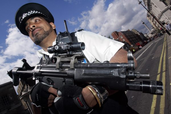 An armed response police officer stands guard on Whitehall, London