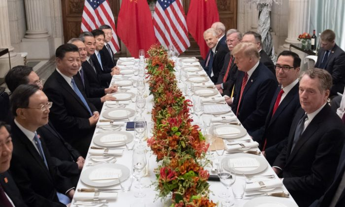 U.S. President Donald Trump (C-R) and Chinese leader Xi Jinping (C-L) along with members of their delegations, hold a dinner meeting at the end of the G20 Leaders' Summit in Buenos Aires, on Dec. 01, 2018. (SAUL LOEB/AFP/Getty Images)