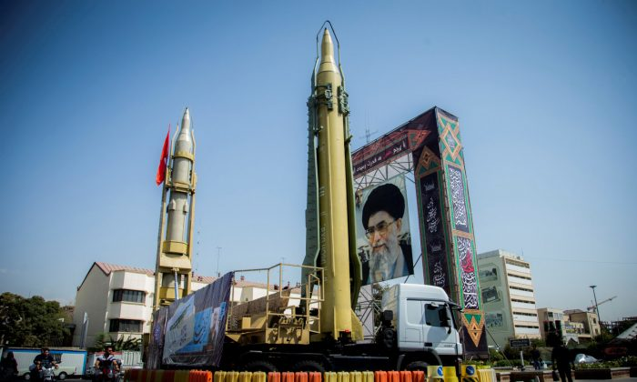 A display featuring missiles and a portrait of Iran's Supreme Leader Ayatollah Ali Khamenei is seen at Baharestan Square in Tehran, Iran on September 27, 2017. (Nazanin Tabatabaee Yazdi/TIMA via Reuters)