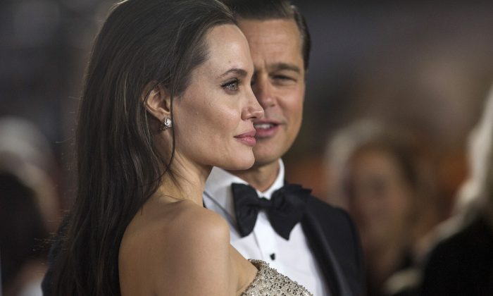 """Director and cast member Angelina Jolie and her husband and co-star Brad Pitt pose at the premiere of """"By the Sea"""" during the opening night of AFI FEST 2015 in Hollywood, California, U.S., November 5, 2015. (Mario Anzuoni/Reuters)"""