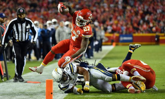Running back Kareem Hunt  27 of the Kansas City Chiefs carries the ball as  free 59dce8340