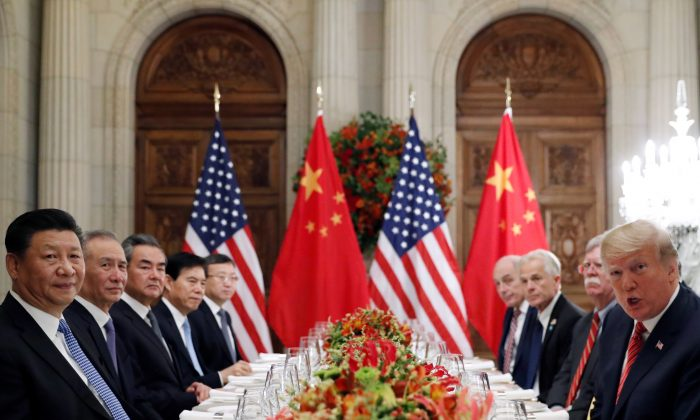 U.S. President Donald Trump, President Trump's national security adviser John Bolton, President Trump's trade and manufacturing policy adviser Peter Navarro and others, as well as Chinese President Xi Jinping's leadership team attend a working dinner after the G20 leaders summit in Buenos Aires, Argentina, on Dec. 1, 2018. (Kevin Lamarque/Reuters)