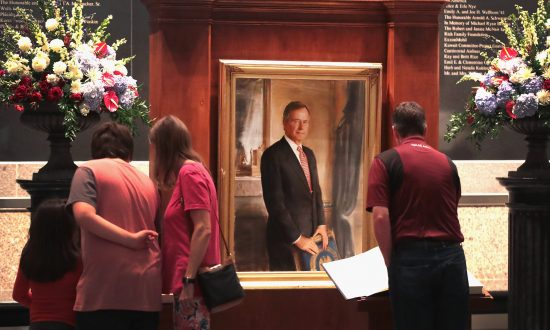 Visitors sign a guest book at the George H.W. Bush Presidential Library Center in College Station, Tex., on Dec. 1, 2018. (Scott Olson/Getty Images)
