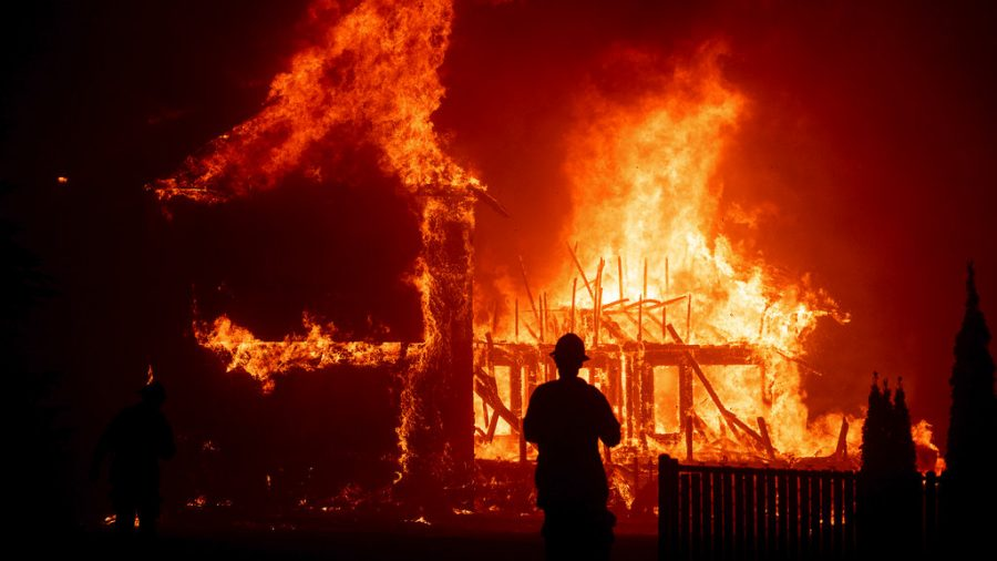 Home burns while a person watches