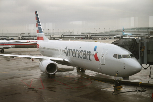 A new American Airlines 737-800 aircraft featuring a new paint job with the company's new logo sits at a gate at O'Hare Airport on Jan. 29, 2013 in Chicago, Illinois. (Scott Olson/Getty Images)