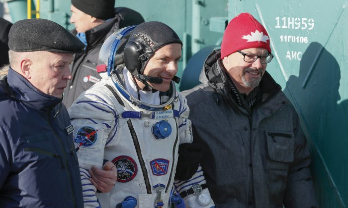 CSA astronaut David Saint Jacques walks to the rocket prior to the launch of Soyuz-FG rocket at the Russian leased Baikonur cosmodrome, Kazakhstan on Dec. 3, 2018. (AP Photo/Shamil Zhumatov, Pool)