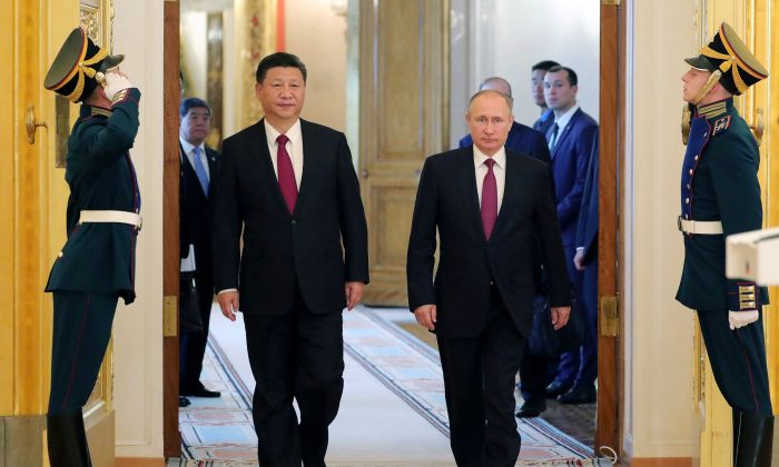 Russian President Vladimir Putin (2nd R) and Chinese President Xi Jinping (2nd L) at the Kremlin in Moscow on July 4, 2017. (Mikhail Klimentiev/AFP/Getty Images)