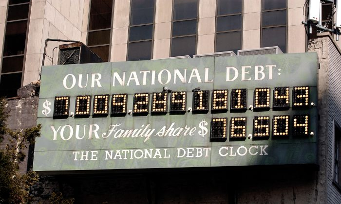 The National Debt Clock is seen in New York City on Feb. 19, 2004. As of July 31, 2018, the national debt stood at $15.6 trillion. (Stephen Chernin/Getty Images)