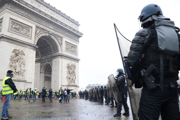 Macron visits damaged Arc de Triomphe after riot