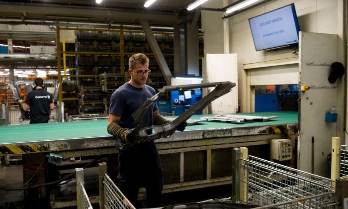An operator works on processed metal at the Gestamp Automocion factory branch in Abrera, near Barcelona, on June 19, 2018. (Josep Lago/AFP/Getty Images)