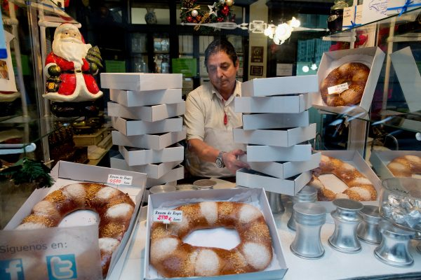 A pastry shop seller prepares orders of pastry for customer at the Antigua Pasteleria del Pozo in Madrid, Spain, in this file photo.