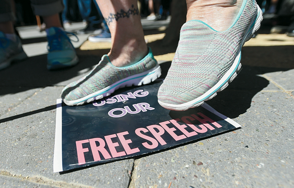 woman_stomps_on_free_speech_sign_on_college_campus