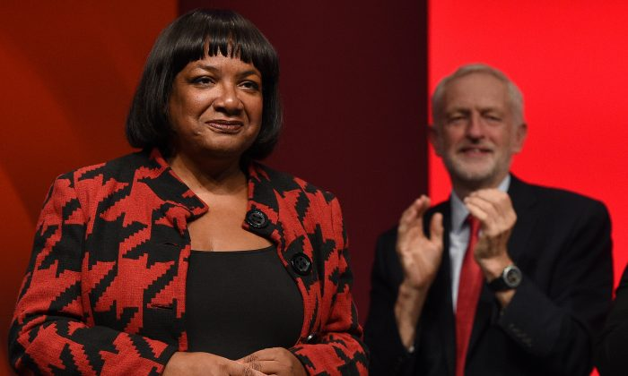Britain's Labour Party leader Jeremy Corbyn (R) applauds Shadow Home Secretary Diane Abbott (L) after she addressed delegates on the third day of the Labour party conference in Liverpool, northwest England, on Sept. 25, 2018. Abbott spoke at the Congressional Progressive Caucus summit in March about socialist politics. (OLI SCARFF/AFP/Getty Images)
