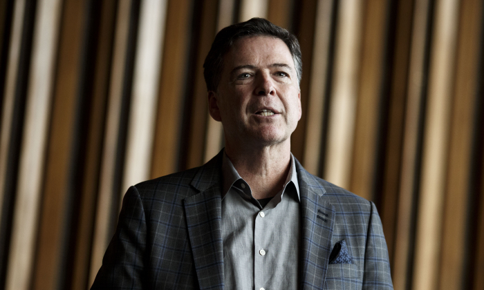 "Former FBI Director James Comey talks backstage before a panel discussion about his book ""A Higher Loyalty"" in Berlin, Germany, on June 19, 2018. Comey is in Berlin at the invitation of the American Academy in Berlin. (Carsten Koall/Getty Images)"