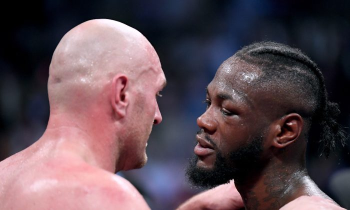 Tyson Fury embraces Deontay Wilder after fighting to a draw during the WBC Heavyweight Championship at the Staples Center, on Dec. 1, 2018 in Los Angeles. (Harry How/Getty Images)
