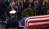 Bob Dole, 95, Is Helped out of Wheelchair to Salute Casket of George HW Bush