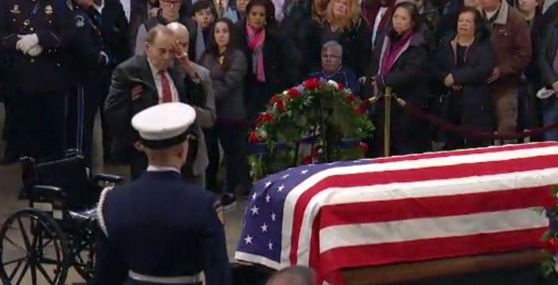 bob dole salutes casket of george hw bush