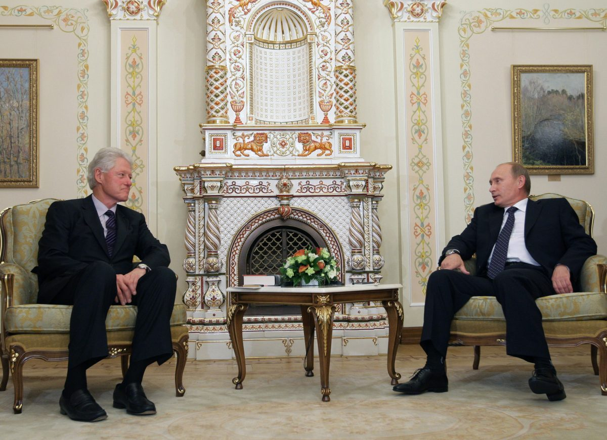 Russia's Prime Minister Vladimir Putin speaks with former President Bill Clinton at the State residence of the Russian President Novo-Ogaryovo outside Moscow on June 29, 2010. On the same day, Clinton was paid $500,000 by Renaissance Capital, a Russian investment bank with ties to Putin, for a 90-minute speech. (ALEXEY DRUZHININ/AFP/Getty Images)