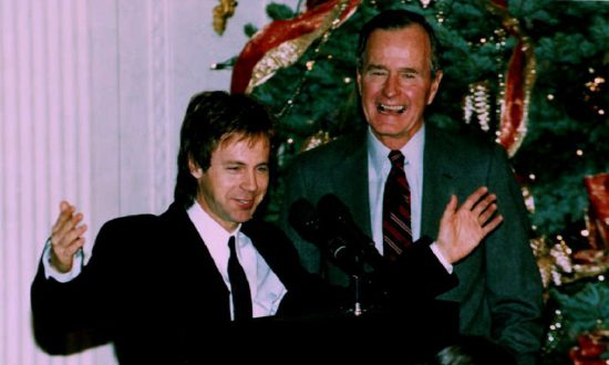 U.S. President George Bush (R) watches as comedian Dana Carvey does his George Bush impersonation on Dec. 7, 1992. Carvey and his wife, Paula, spent the night at the White House as guests of President Bush and First Lady Barbara Bush. (ROBERT GIROUX/AFP/Getty Images)