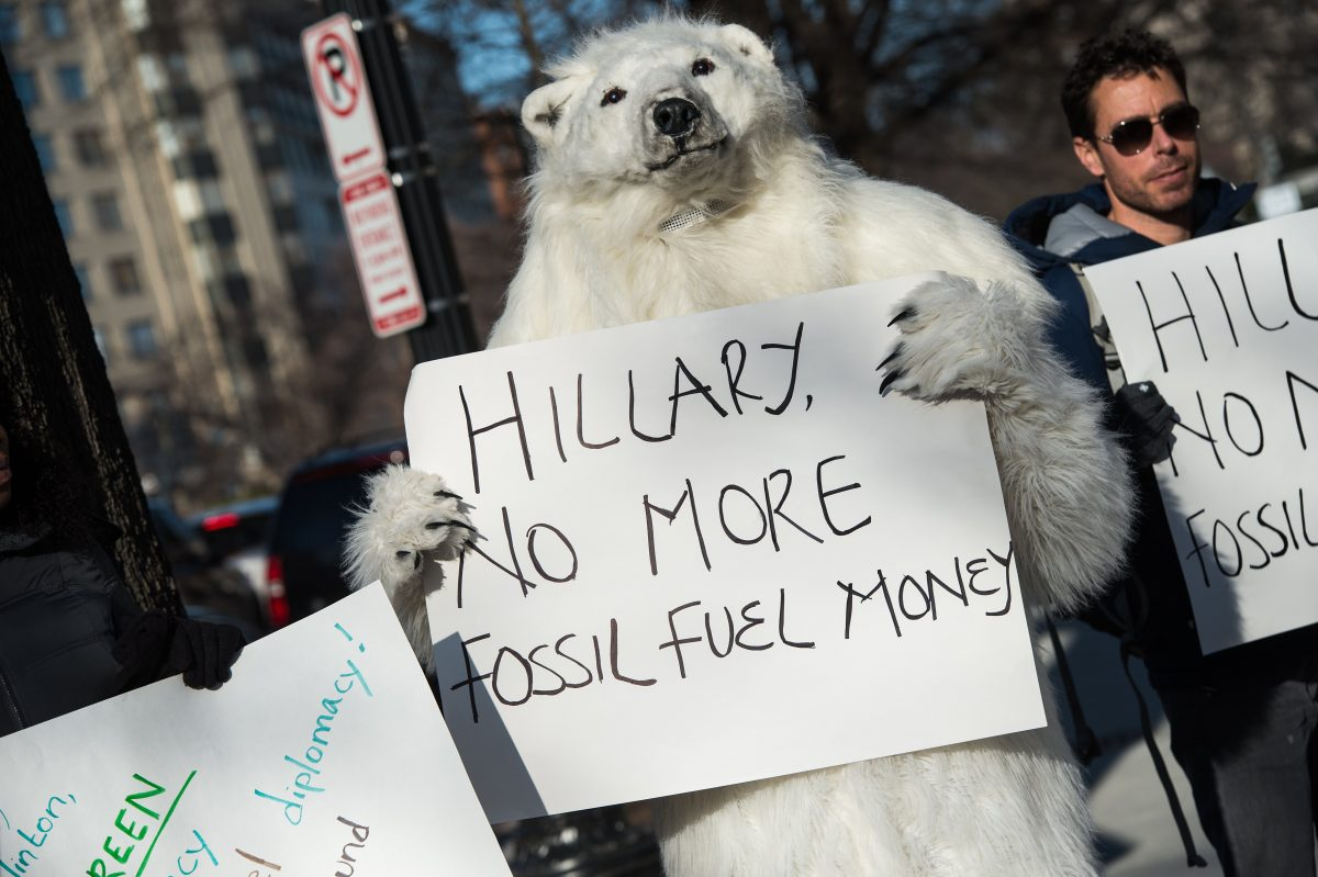 Environmental activists protest against the proposed Keystone XL pipeline in front of the Center for Strategic and International Studies (SCIS) where former US Secretary of State Hillary Clinton is speaking on March 23, 2015. (NICHOLAS KAMM/AFP/Getty Images)