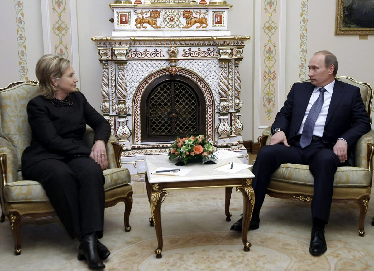 Then-Secretary of State Hillary Clinton meets with Russian Prime Minister Vladimir Putin at the State residence of the Russian President Novo-Ogaryovo outside Moscow on March 19, 2010. (ALEXEY NIKOLSKY/AFP/Getty Images)