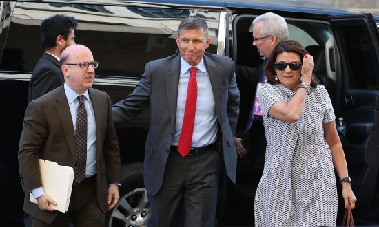 Michael Flynn (C), former national security adviser to President Donald Trump, arrives at the E. Barrett Prettyman Federal Courthouse in Washington on July 10, 2018. (Mark Wilson/Getty Images)