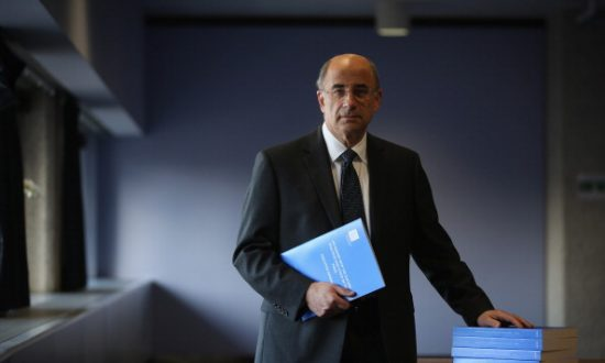 Lord Justice Leveson poses with a summary report into press standards on November 29, 2012 in London, England. His findings were subsequently used to reduce press freedom in the United Kingdom. (Dan Kitwood/Getty Images)