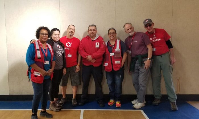 Pamela Harris (L) with several Red Cross volunteers and workers. (Courtesy of the American Red Cross)