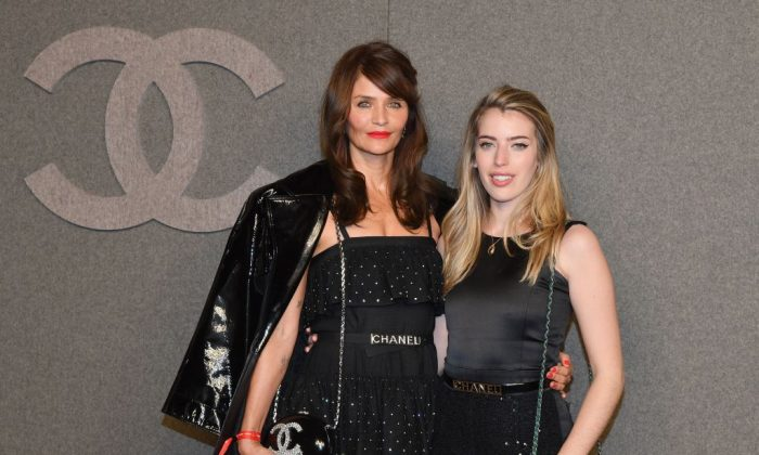 Danish model Helena Christensen and guest at the Chanel Metiers D'Art 2018/19 Show at The Metropolitan Museum of Art in New York City on Dec. 4, 2018. (Angela Weiss/AFP/Getty Images)