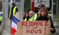 Macron Scraps French Fuel Tax Hike Amid Violent Protests