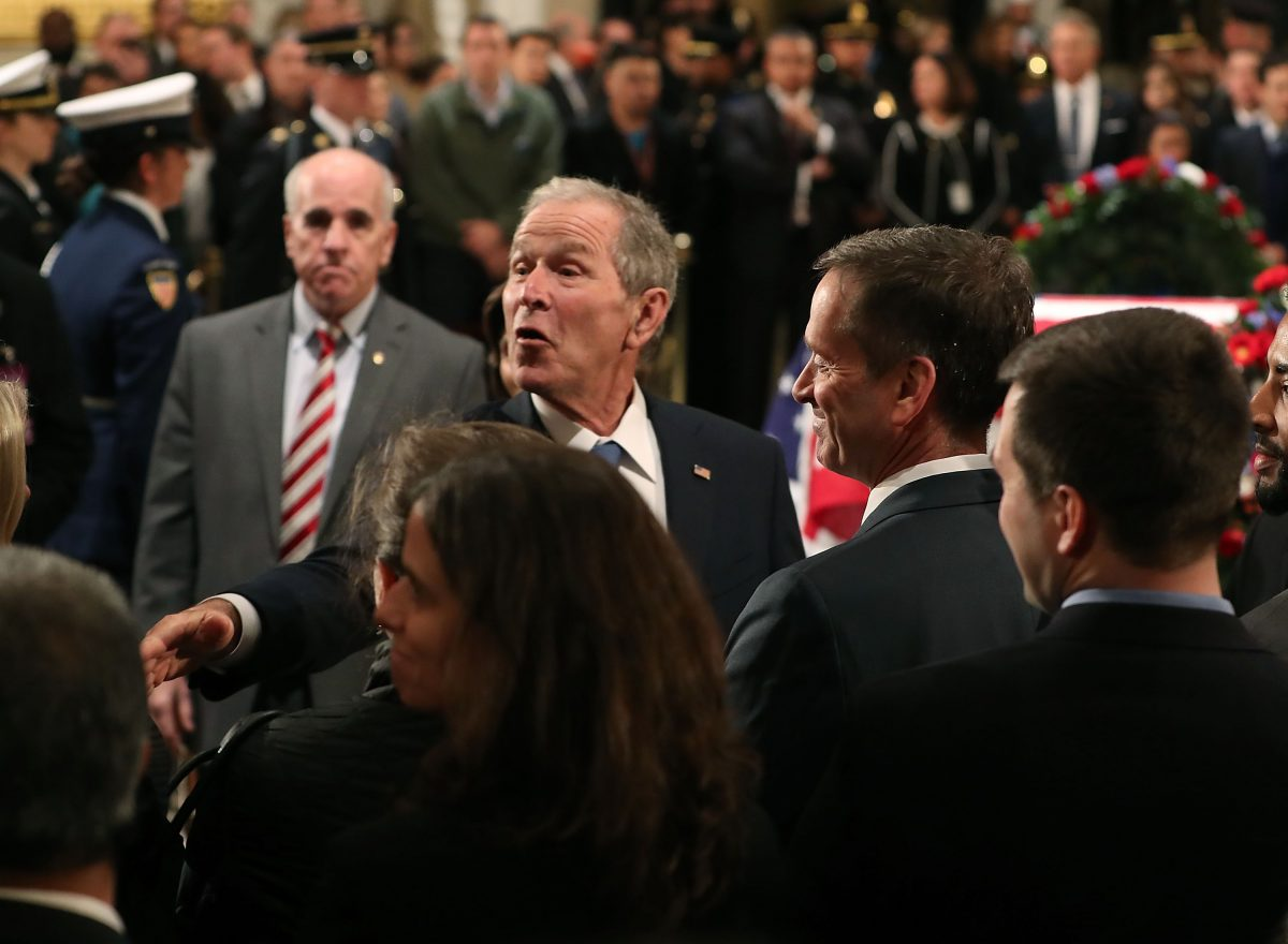 george bush meets mourners