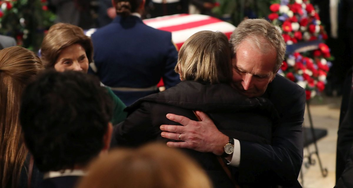 President George H.W. Bush Lies In State At U.S. Capitol with son