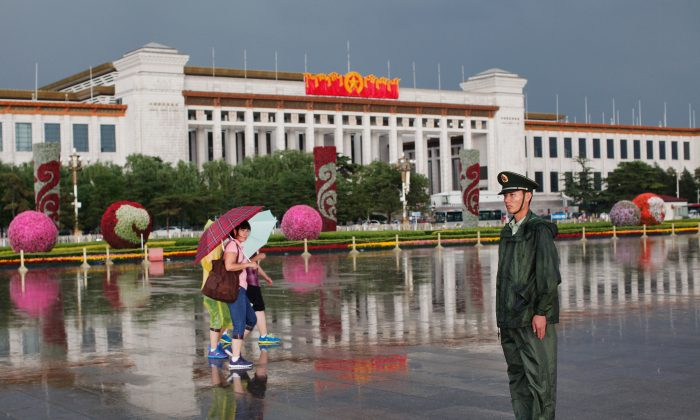 A Chinese paramilitary policeman stands guard at Tiananmen Square in Beijing on June 9, 2012. (Lintao Zhang/Getty Images)