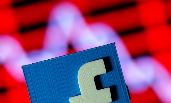 A 3D-printed Facebook logo is seen in front of a displayed stock graph in this illustration taken on Nov. 3, 2016. (Dado Ruvic/Illustration/Reuters)
