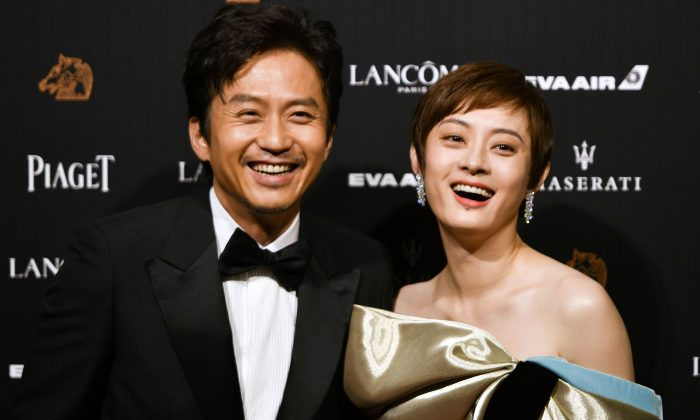 Chinese actor Deng Chao and actress Sun Li arrive on the red carpet of the 55th Golden Horse film awards, dubbed the Chinese 'Oscars', in Taipei on November 17, 2018. (SAM YEH/AFP/Getty Images)