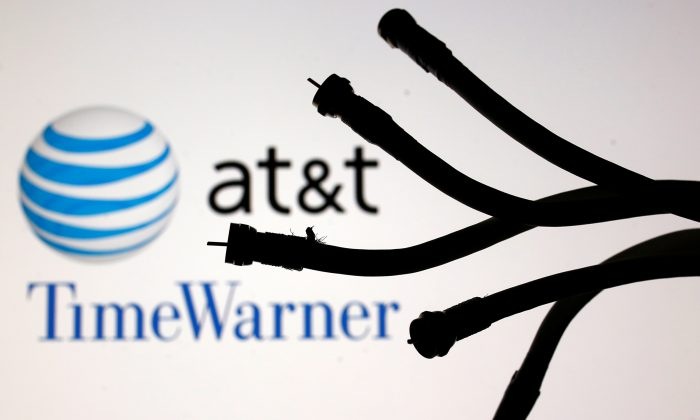 Coaxial TV Cables are seen in front of AT&T and Time Warner logos in this picture illustration taken on June 13, 2018. (Dado Ruvic/Illustration/Reuters)
