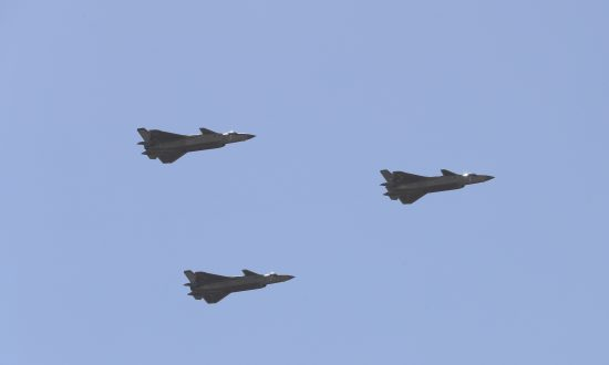 Chinese J-20 stealth fighter jets fly past during a military parade at the Zhurihe training base in China's northern Inner Mongolia region on July 30, 2017. China held a parade of its armed forces on July 30 to mark the 90th anniversary of the People's Liberation Army (PLA). (STR/AFP/Getty Images)