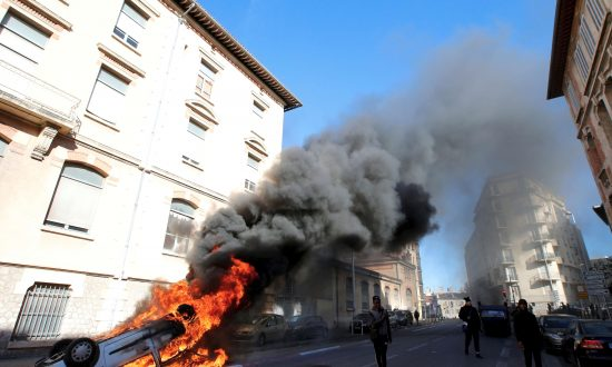 A burning car in the street as youths and high-school students clash with police during a demonstration against the French government's reform plan in Marseille, France, on Dec. 6, 2018. (Reuters/Jean-Paul Pelissier)