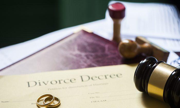 Divorce decree and wooden gavel. (Shutterstock)