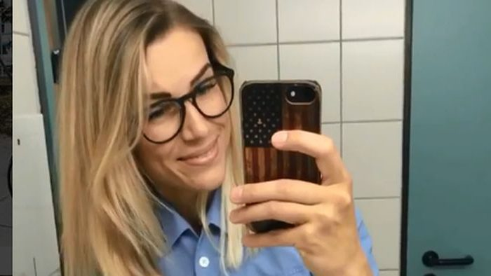 """A woman who has been dubbed """"Germany's most beautiful policewoman"""" was told that she has to choose between being a police officer or being a model. (Adrienne Koleszar / Instagram)"""