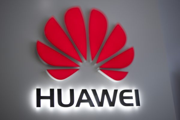 The Huawei logo is displayed at a store in Beijing on December 6, 2018.