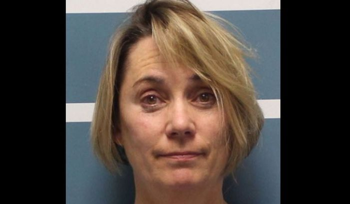Margaret Gieszinger, 52, was arrested after police got word of a teacher endangering students with scissors at University Preparatory High School in Visalia, California, according to the Visalia Times-Dispatch in a Dec. 5 report. (Tulare County Sheriff's Office)